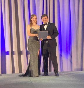 Austin Underwood receiving his award from International President Tana Early.